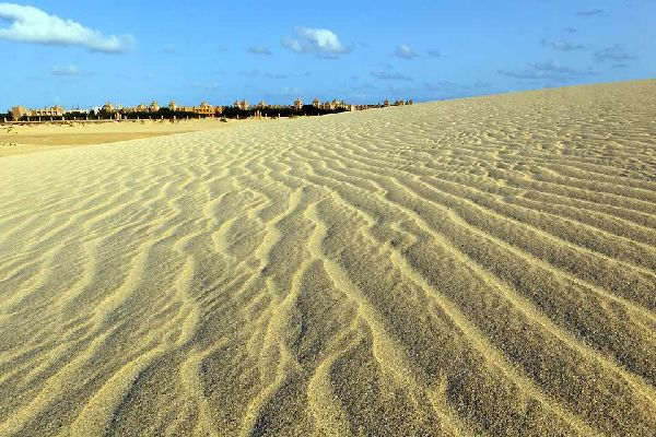 Due to its international airport, Sal is the most well-known of the Cape Verdean islands.  People rarely travel to Sal for its landscape; its flat terrain is arid and dry. The highest point of the island is Monte Grande (1332 ft). Although Sal's beaches have their own charm, there are no fine white sandy beaches. The island stretches 18 miles north to south and 7 miles from east to west. Today the ...