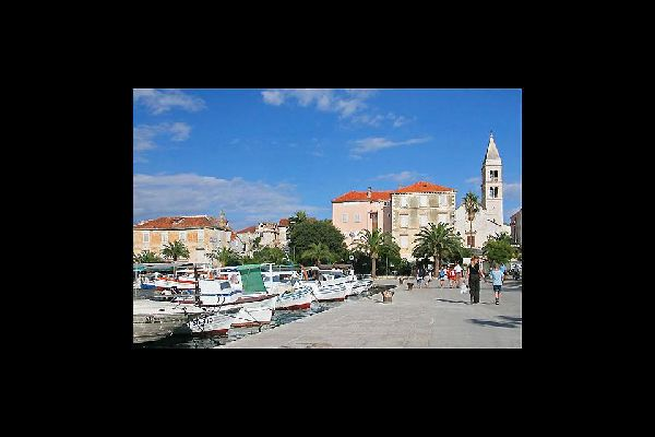 Tourists take a promenade along the marina in Split, the largest city in southern Croatia