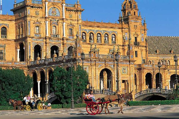45 mi from the sea, Seville is still beaming with the splendours of the Muslim era: palaces, gardens and old mosques which have now become churches or the cathedral, blend together with the riches brought back from America; surrounded by flamenco, corridas, ferias and tapas. The pedestrian centre, lined with orange trees (there is a total of 80,000!) and Neo-Mudejar style façades is totally enchanting. ...