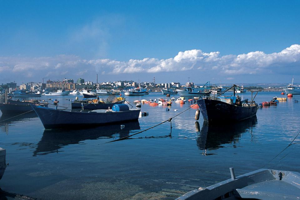 """The Mar Grande, the sea outside of the city, is more often known as the """"harbour of the Grand Sea"""" as it is here where the navy ships are docked in waiting"""