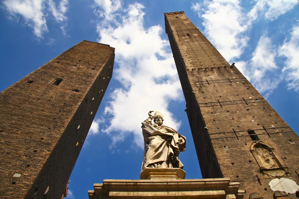 The Two Towers are the symbol of the city: the Asinelli Tower and the Garisenda Tower were commissioned by Ghibelline nobles in the 12th century.