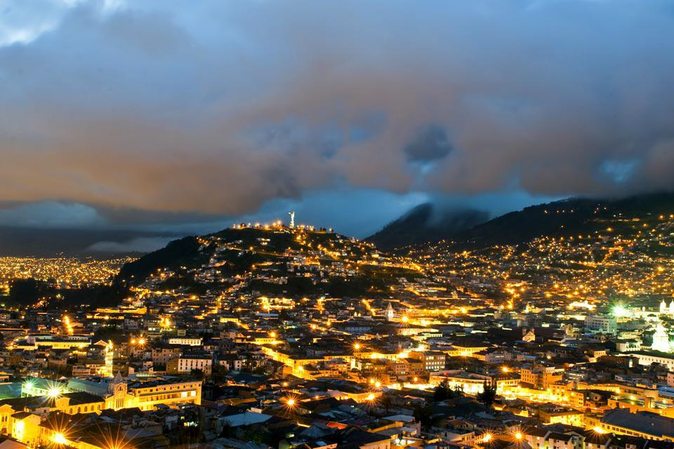 Quito is a city surrounded by volcanoes and green hills, making for a remarkable view both day and night.