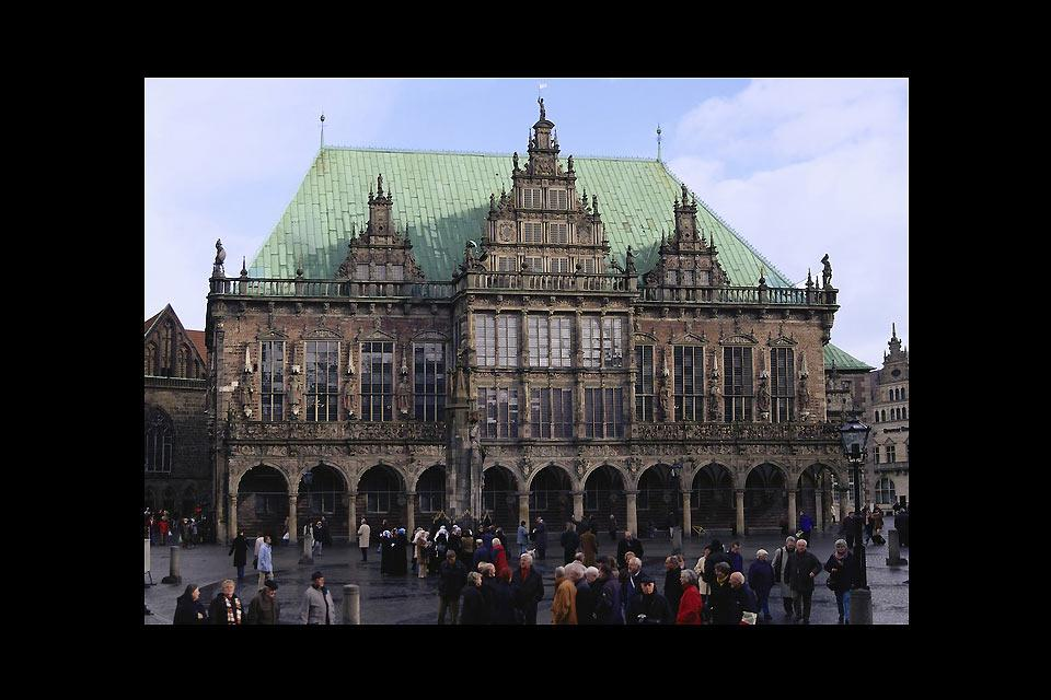 Standing on the market square, the iconic Bremen Roland statue watches over the town hall.