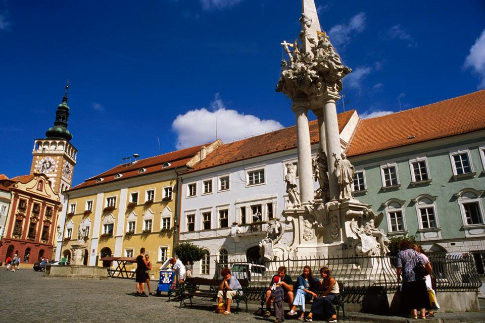 People sitting around the Marianne column in Mikulov.