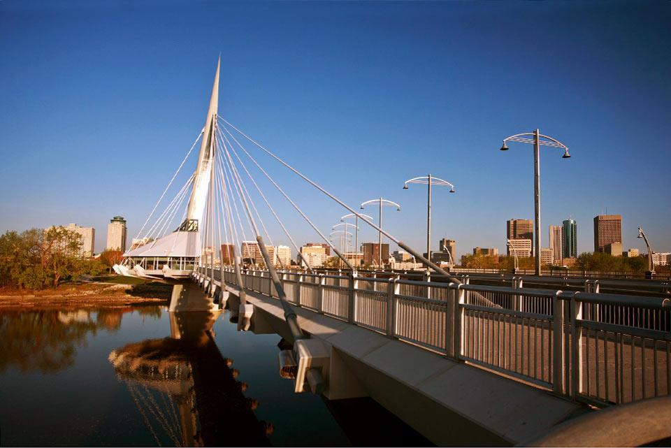 "Winnipeg, the capital of Manitoba, is the largest city in the region of the Prairies, and is even more distinguished than Toronto for its cultural diversity, being the product of multiple waves of immigration. ""The Forks"", the central point of the city, where its inhabitants have gathered for more than 6,000 years, is on the confluence of the Rouge and Assiniboine rivers. The venue for some hundred ..."