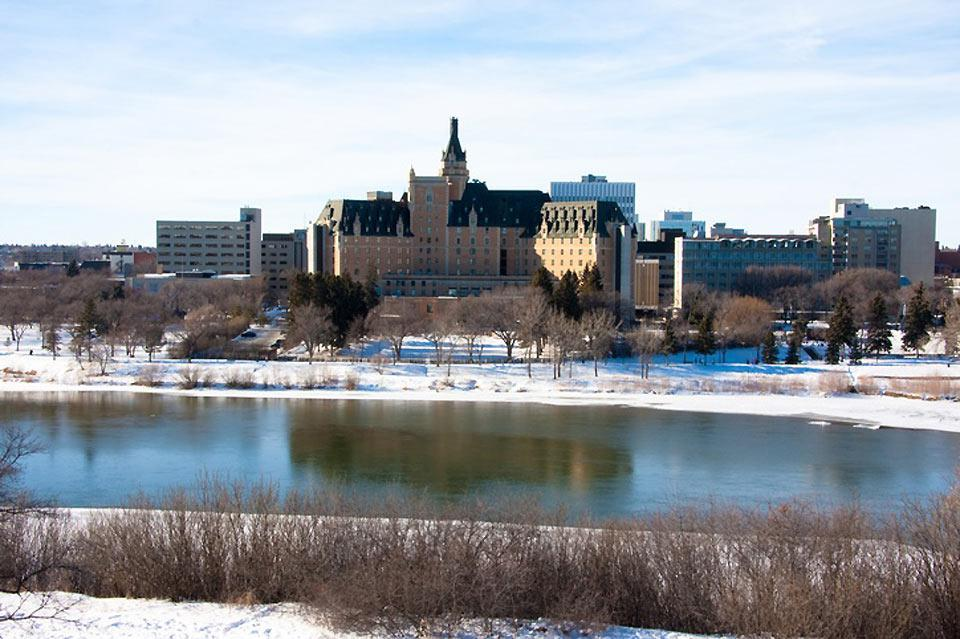 A view of downtown Saskatoon, with the South Saskatchewan River in the foreground