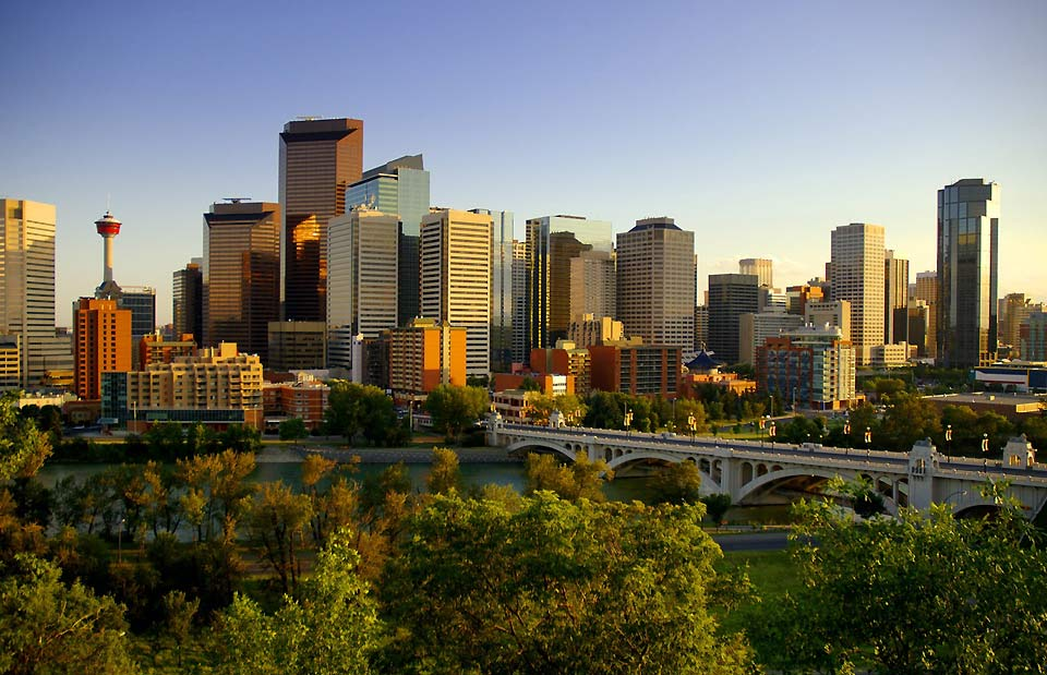 A cityscape of Calgary with the Bow River flowing in the foreground