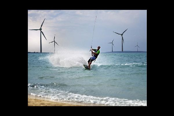 The Zadar coastline offers great watersports, here in front of some wind turbines