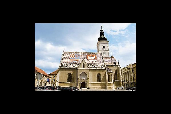 The coat of arms of Zagreb appears on the church's roof
